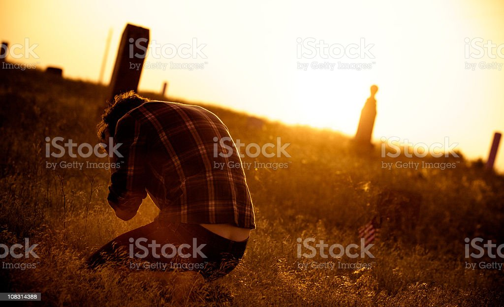 Farmboy and country graveyard royalty-free stock photo