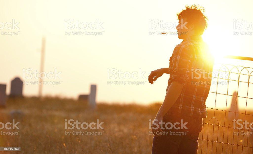 Farmboy and country graveyard stock photo