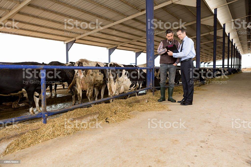 Farmer and Financial Advisor stock photo