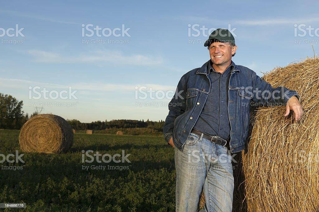 Farmer and Hay Bail royalty-free stock photo