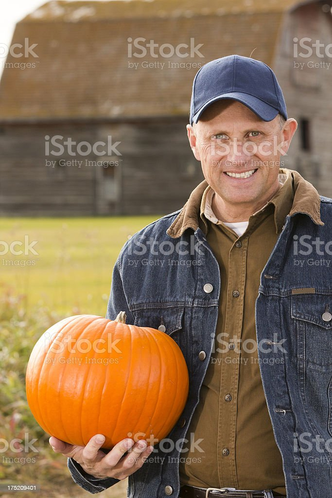 Farmer and Pumpkin royalty-free stock photo