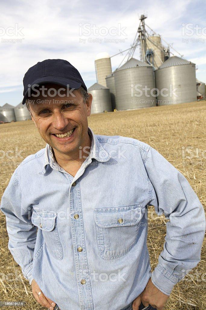 Farmer and Silos royalty-free stock photo