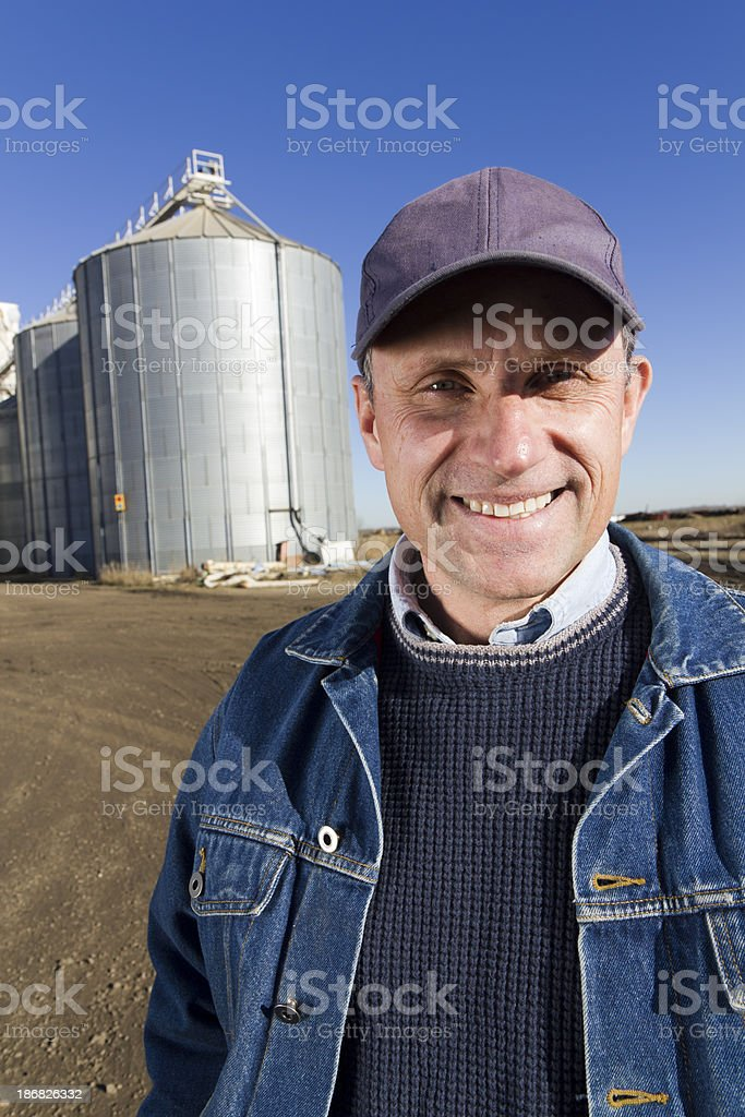 Farmer and Silos stock photo