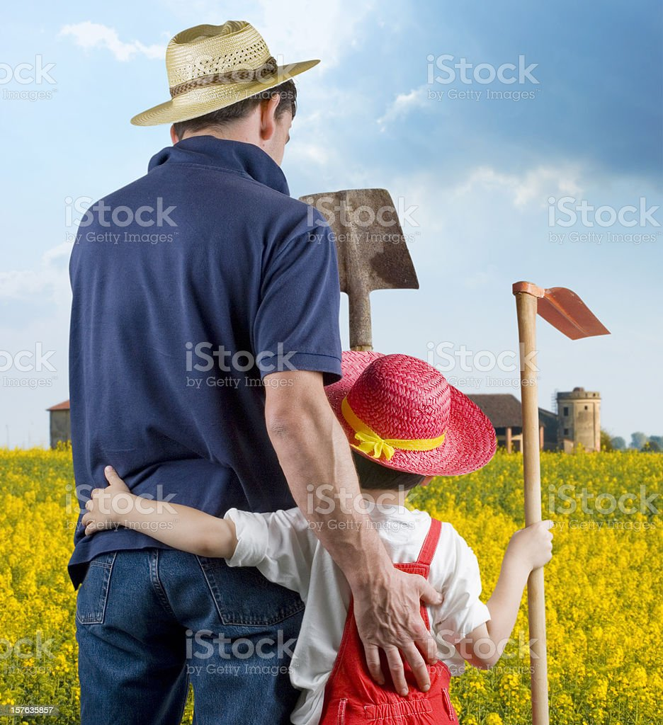 Farmer and Son against yellow field royalty-free stock photo
