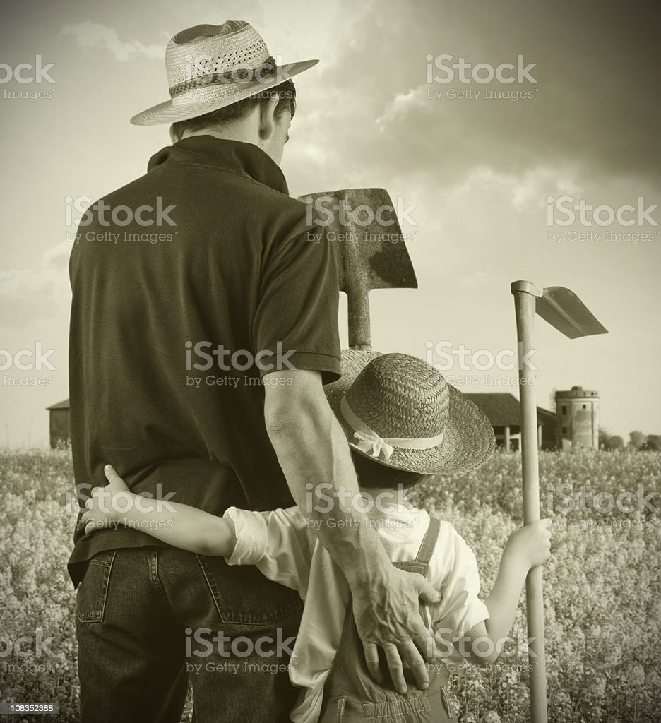Farmer and Son - Sepia Tones royalty-free stock photo