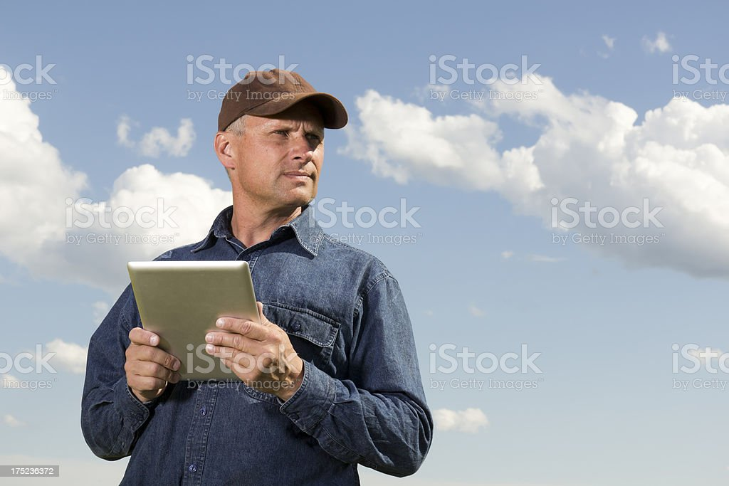 Farmer and Tablet Computer royalty-free stock photo