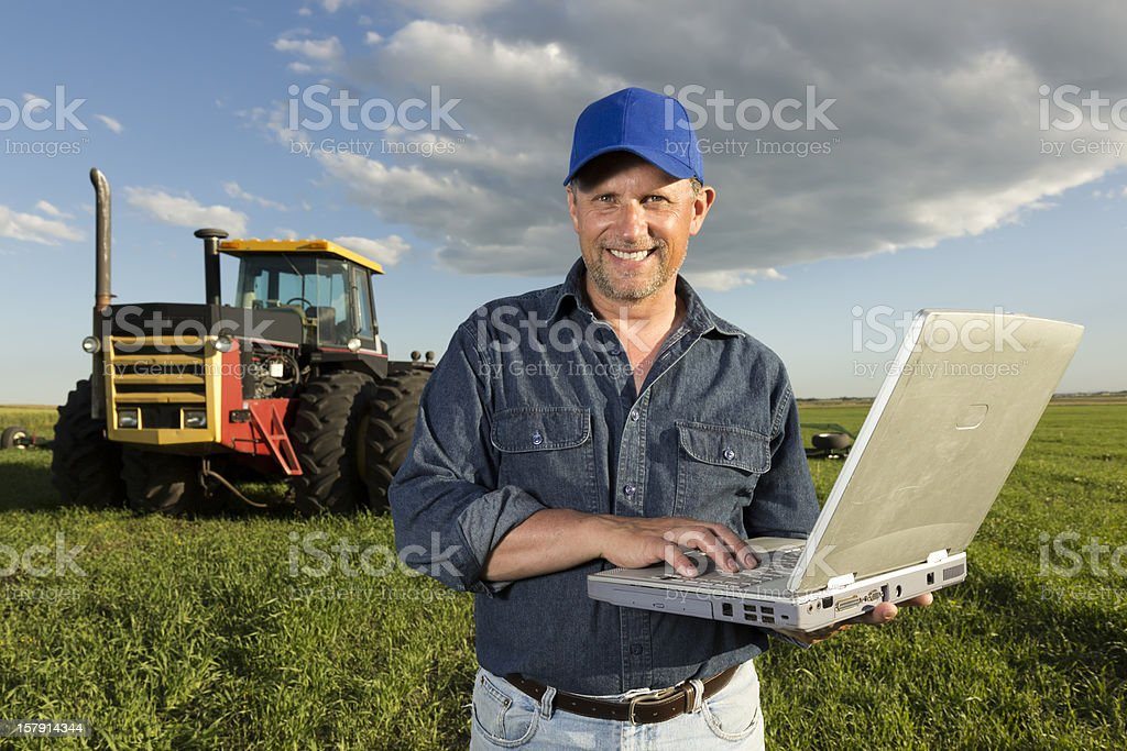 Farmer and Technology royalty-free stock photo
