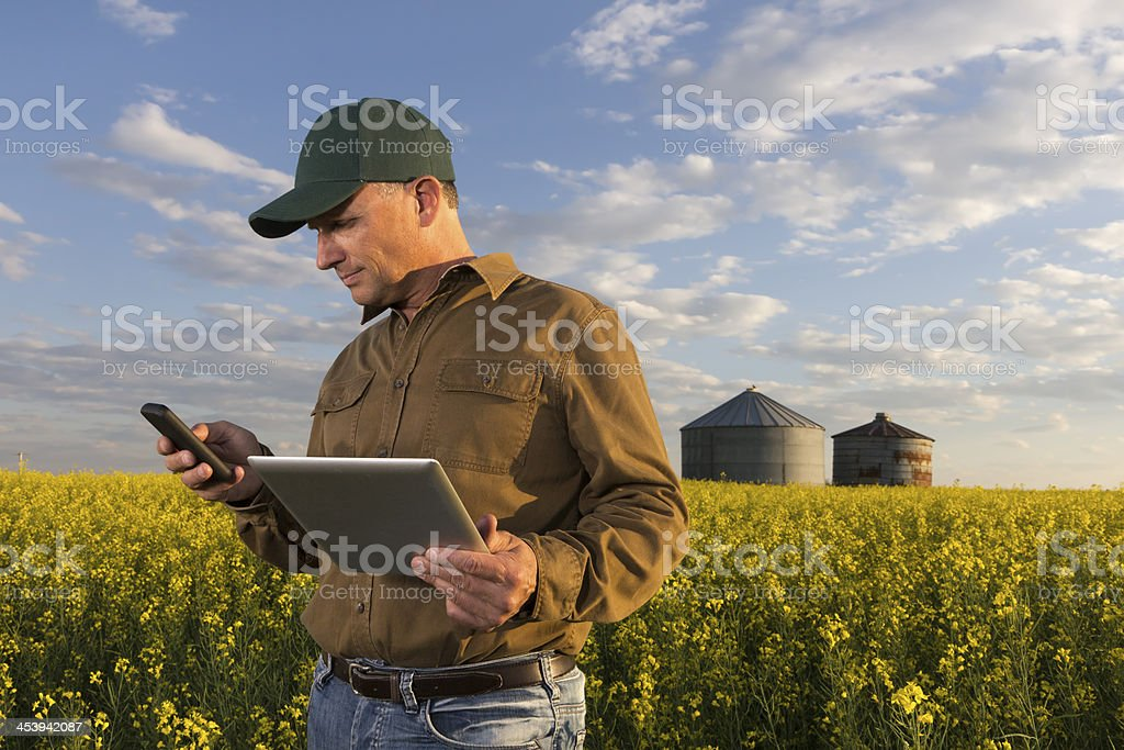 Farmer and Technology stock photo