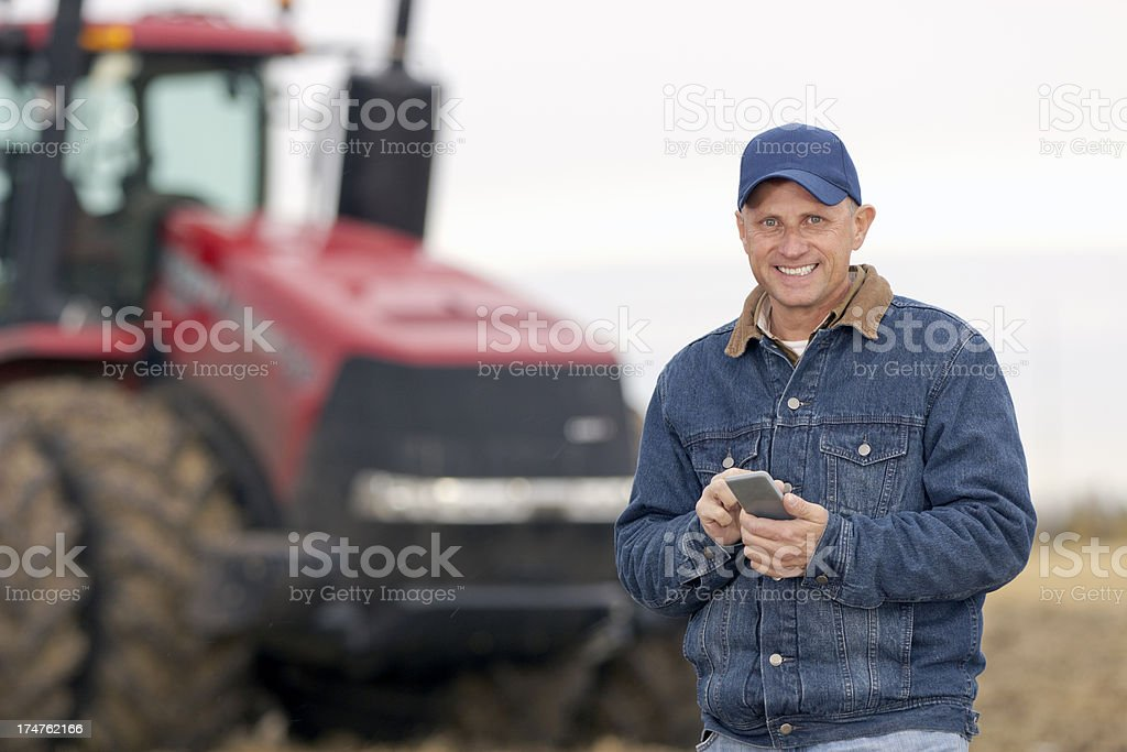 Farmer and Texting stock photo
