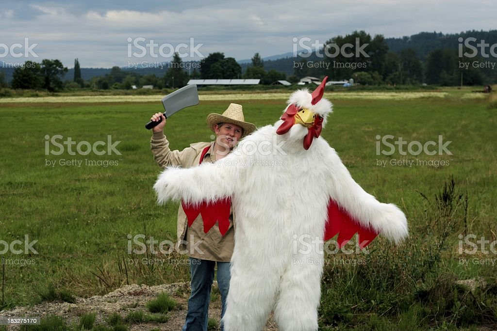 Farmer Chasing Rooster stock photo