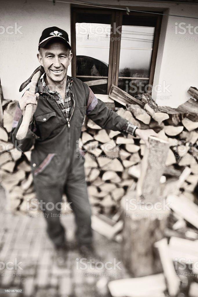 Farmer Chopping Wood royalty-free stock photo