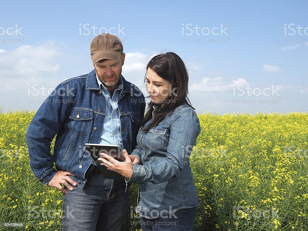 Farmer Couple and Tablet stock photo