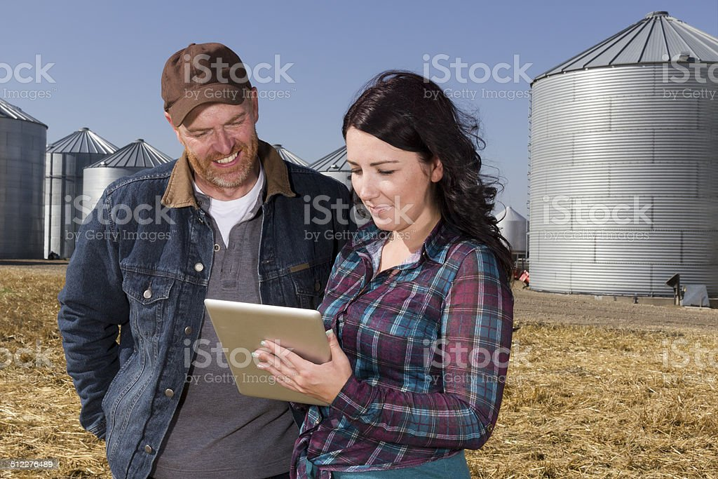 Farmer Couple and Technology stock photo