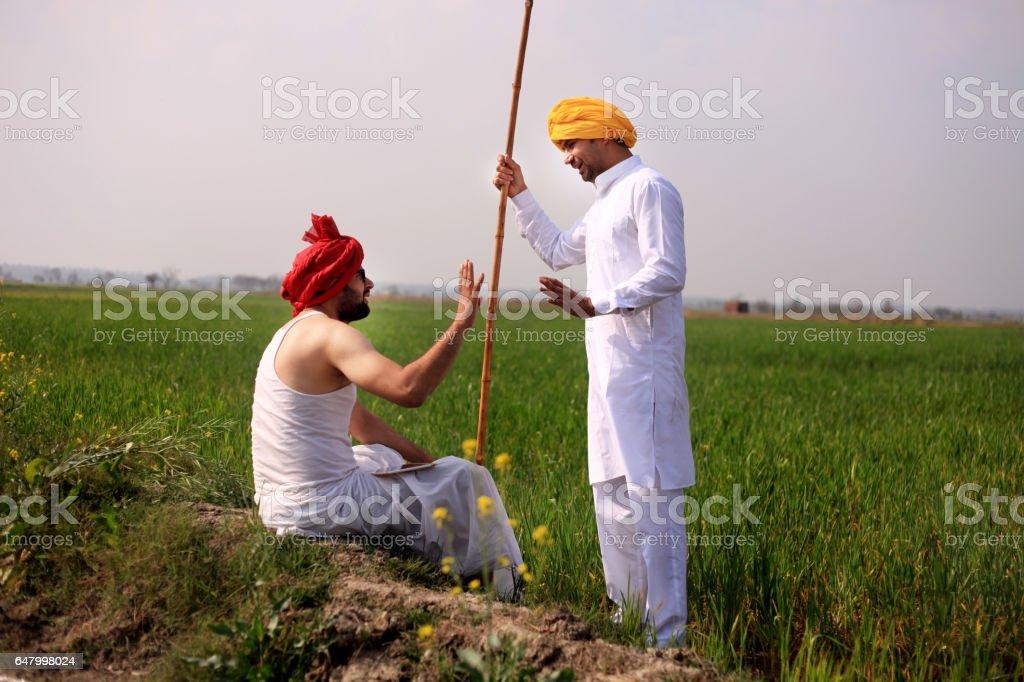 Farmer discussion stock photo