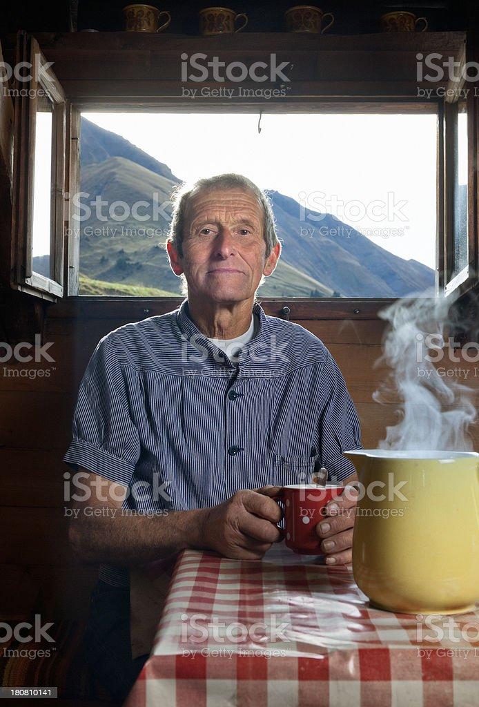 farmer drinking coffee in farmhouse, Switzerland royalty-free stock photo