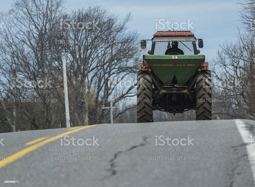 Farmer Drives Tractor stock photo