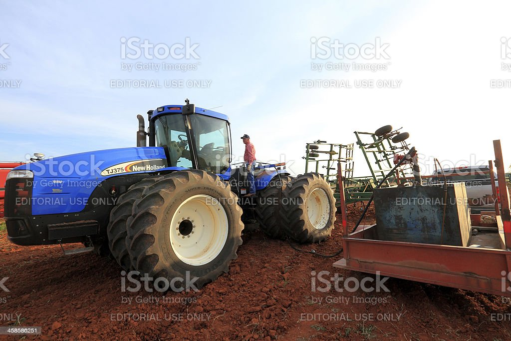 Farmer Fueling Up His Tractor royalty-free stock photo