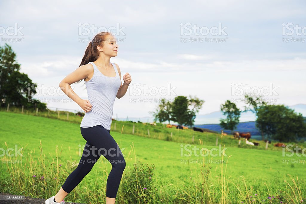 Farmer girl goes running stock photo
