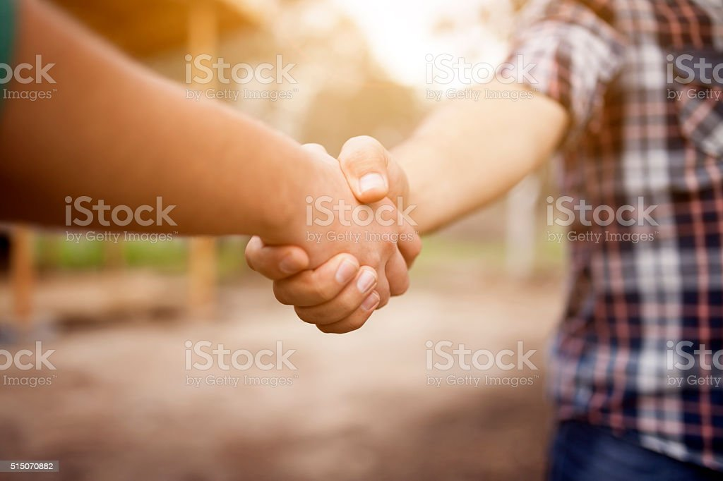 Farmer Handshake stock photo
