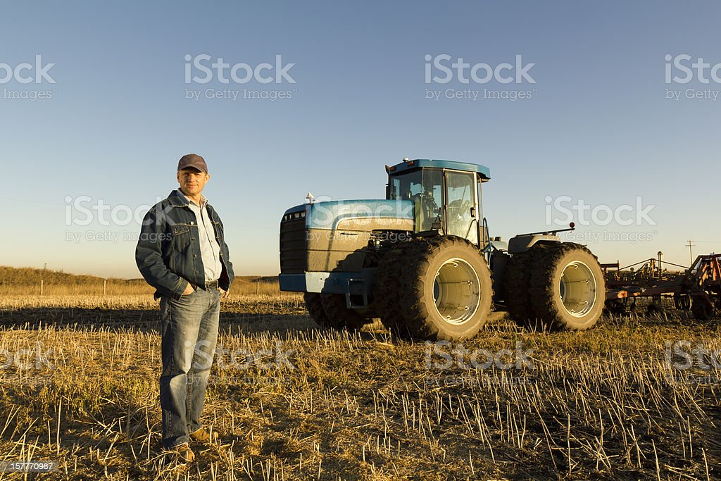 Farmer in a Harvested Field royalty-free stock photo