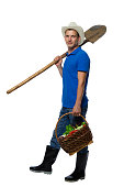 farmer in boots with a shovel