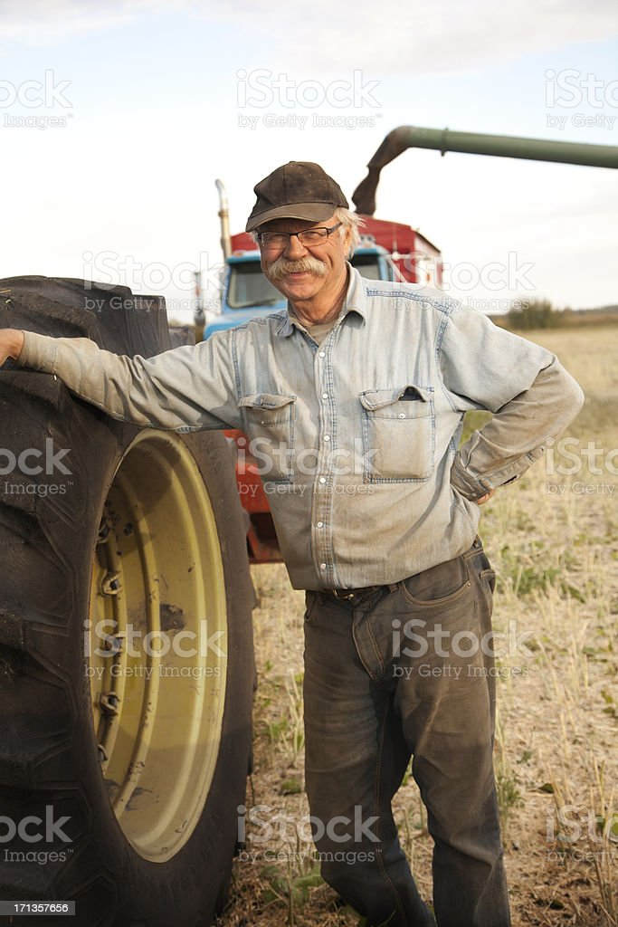 Farmer in Field at Harvest royalty-free stock photo
