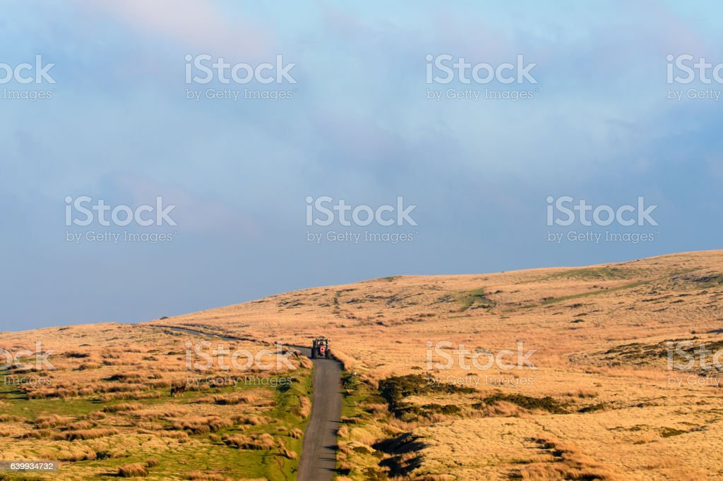 Farmer in red tractor in Brecon Beacons National Park stock photo