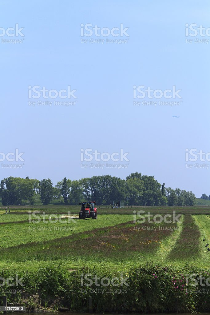 farmer mowing his land royalty-free stock photo