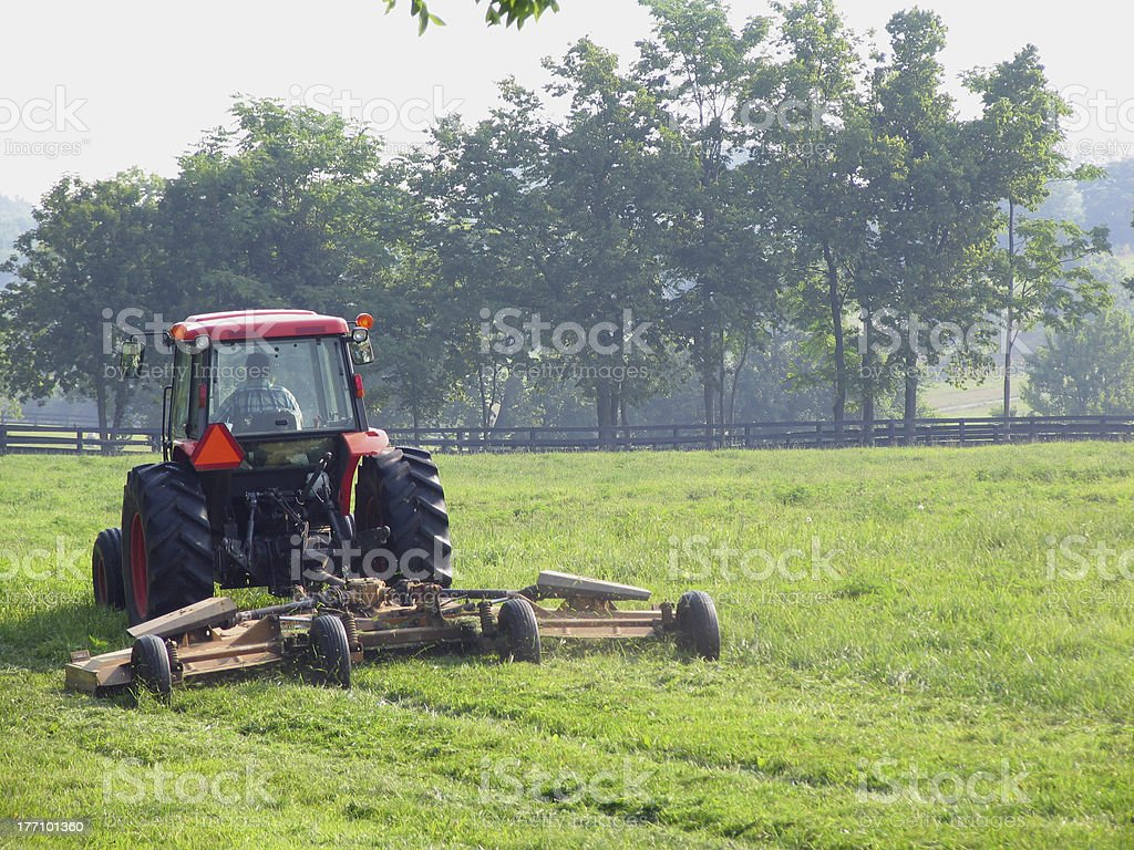 Farmer Mowing w/ Tractor royalty-free stock photo