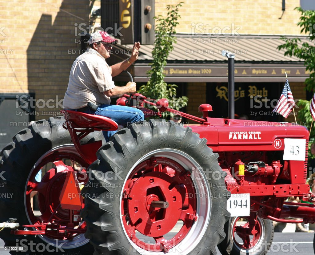 Farmer on his tractor stock photo