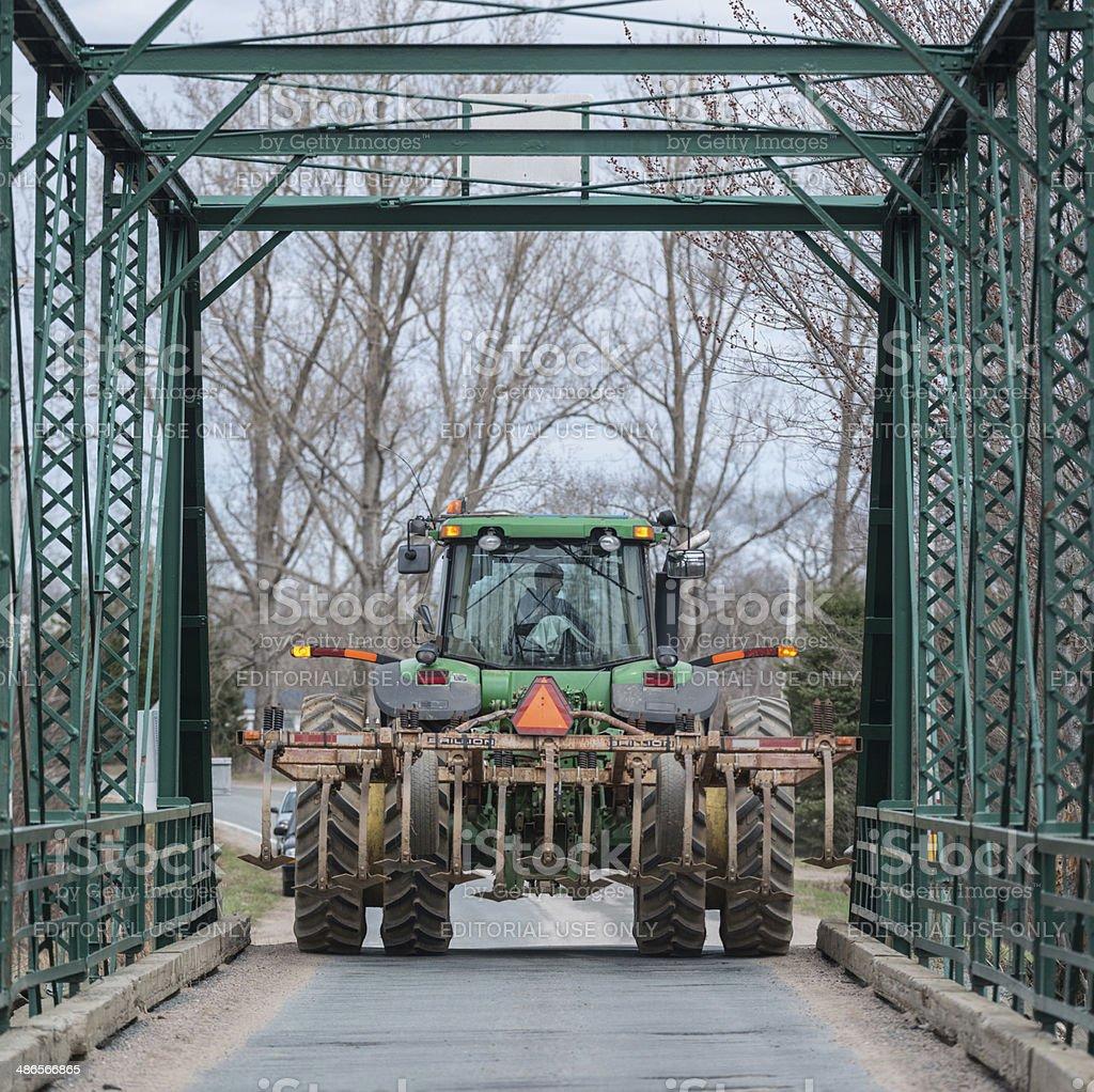 Farmer on Narrow Bridge royalty-free stock photo