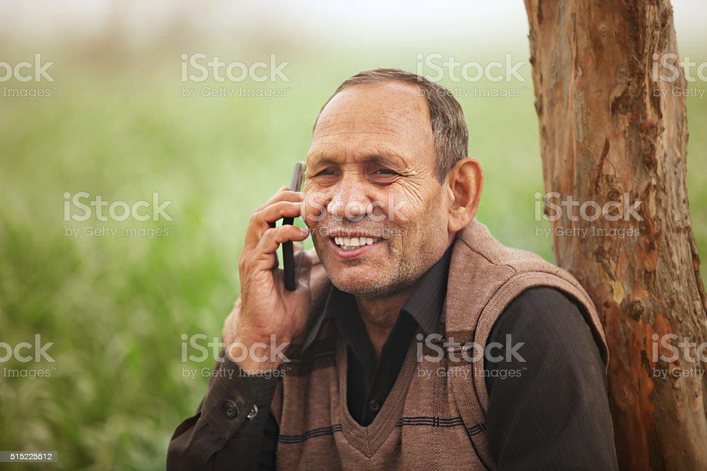 Farmer on smartphone stock photo