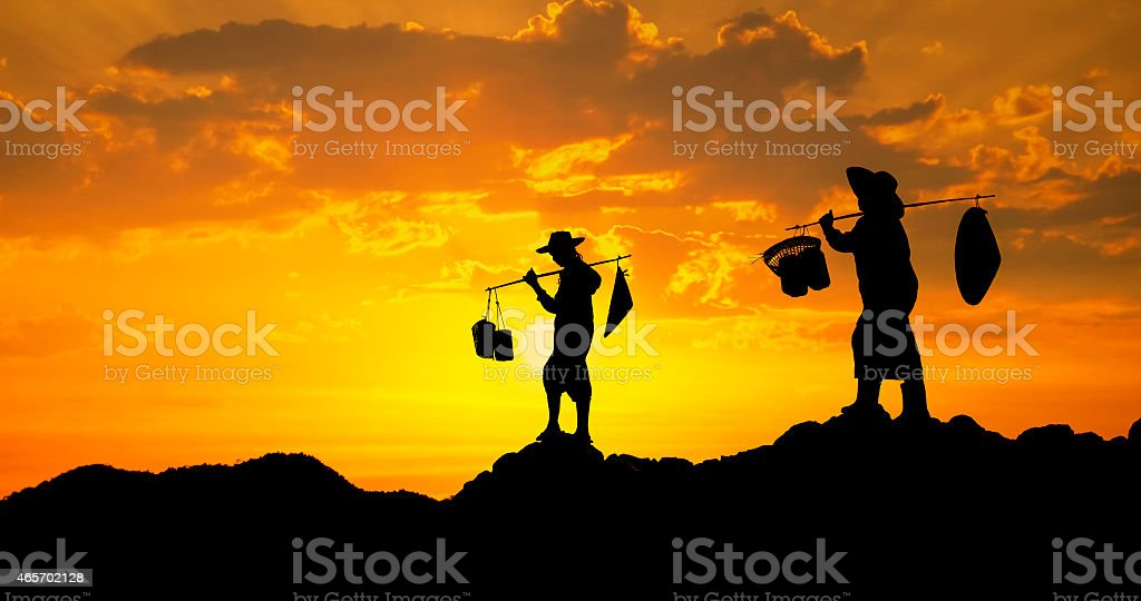 Farmer on sunset stock photo