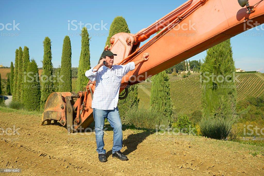Farmer on the phone stock photo