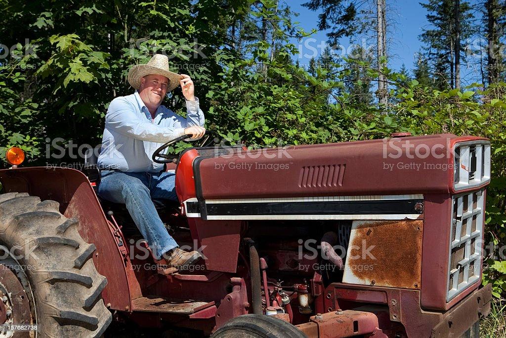 Farmer On Tractor stock photo