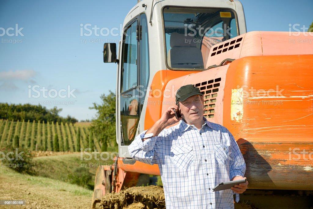 Farmer phoning stock photo
