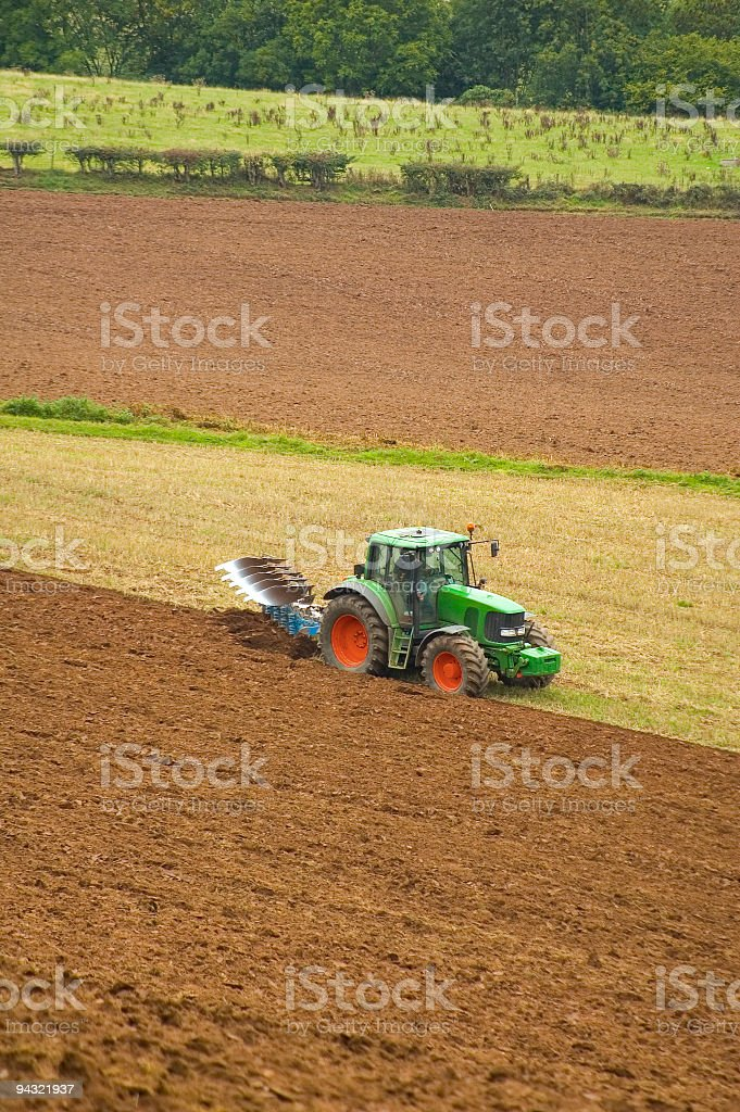 Farmer plowing field stock photo