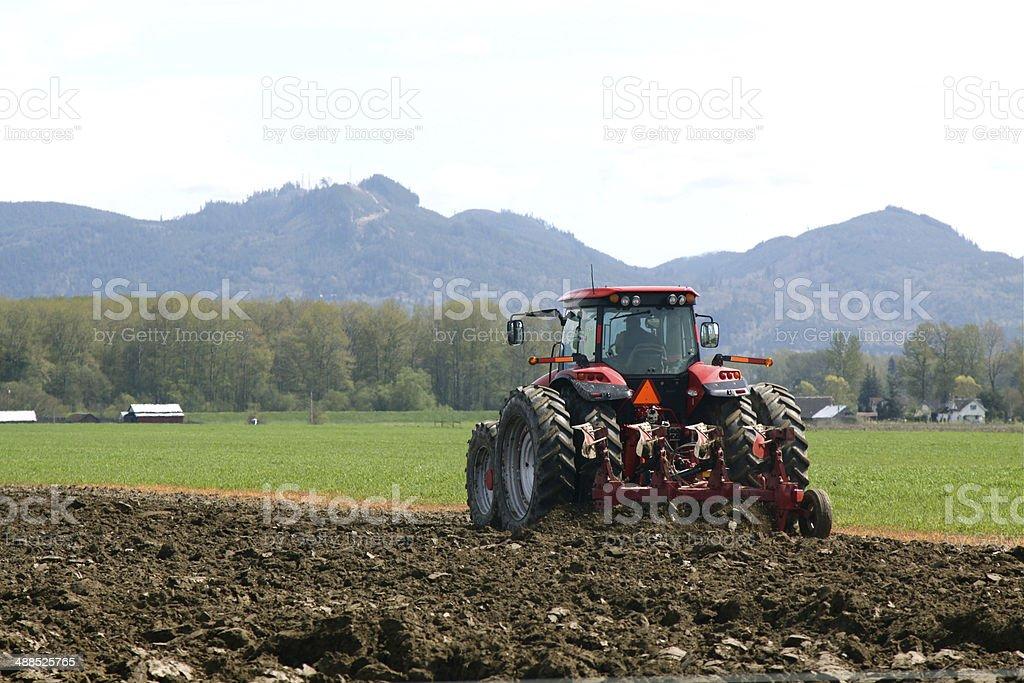 Farmer Plowing HIs Field stock photo