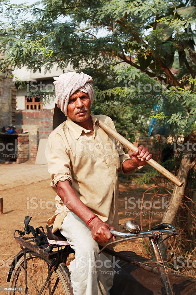 Farmer portrait on his Cycle stock photo