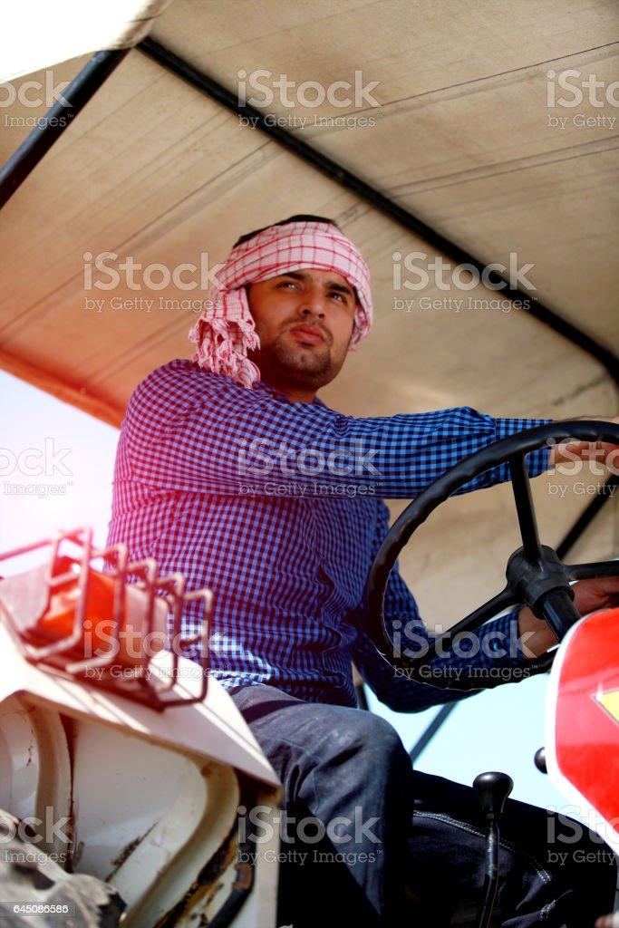 Farmer portrait while driving tractor stock photo