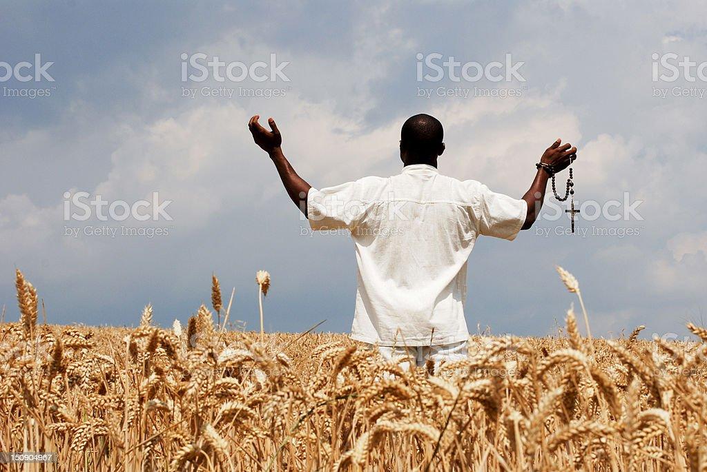 Farmer praying for good year royalty-free stock photo