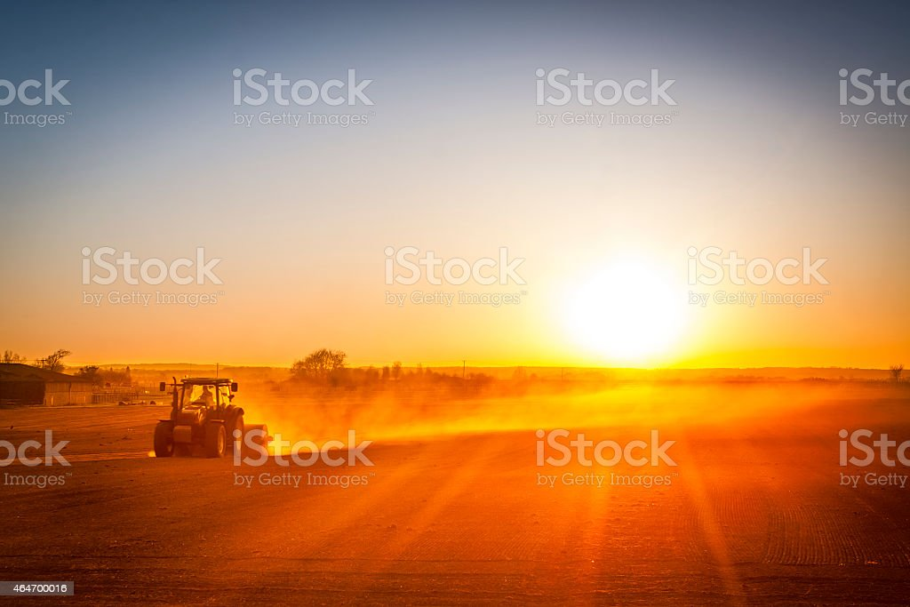 Farmer preparing his field in a tractor ready for spring stock photo