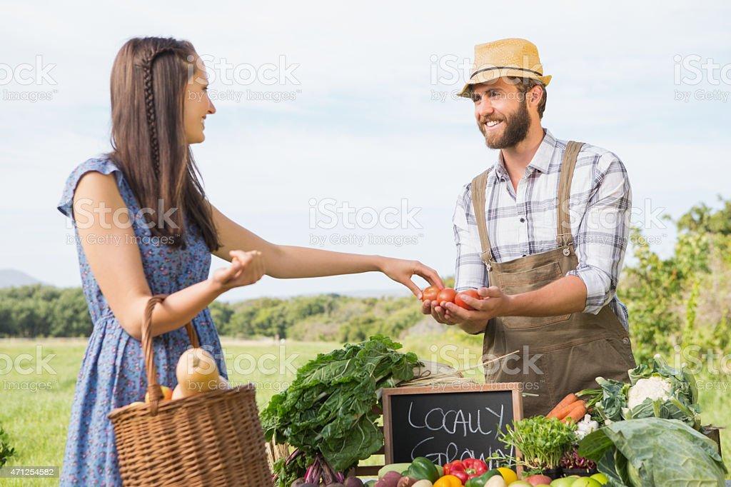 Farmer selling his organic produce stock photo