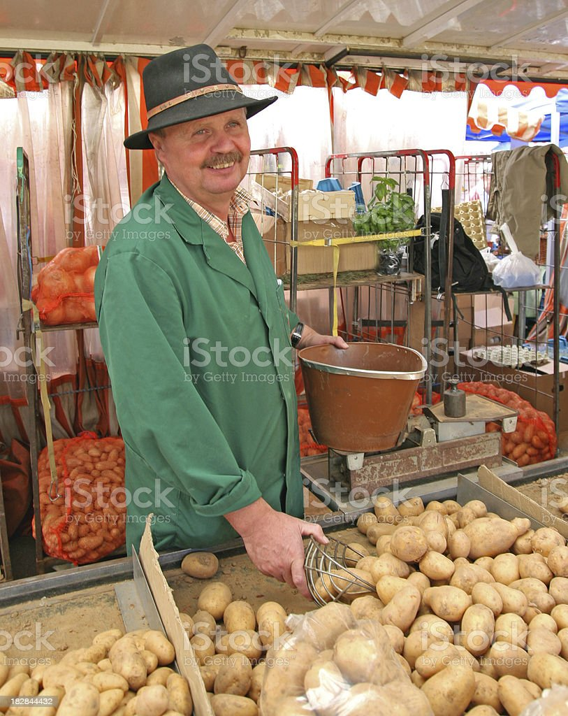 Farmer Selling Potatoes royalty-free stock photo