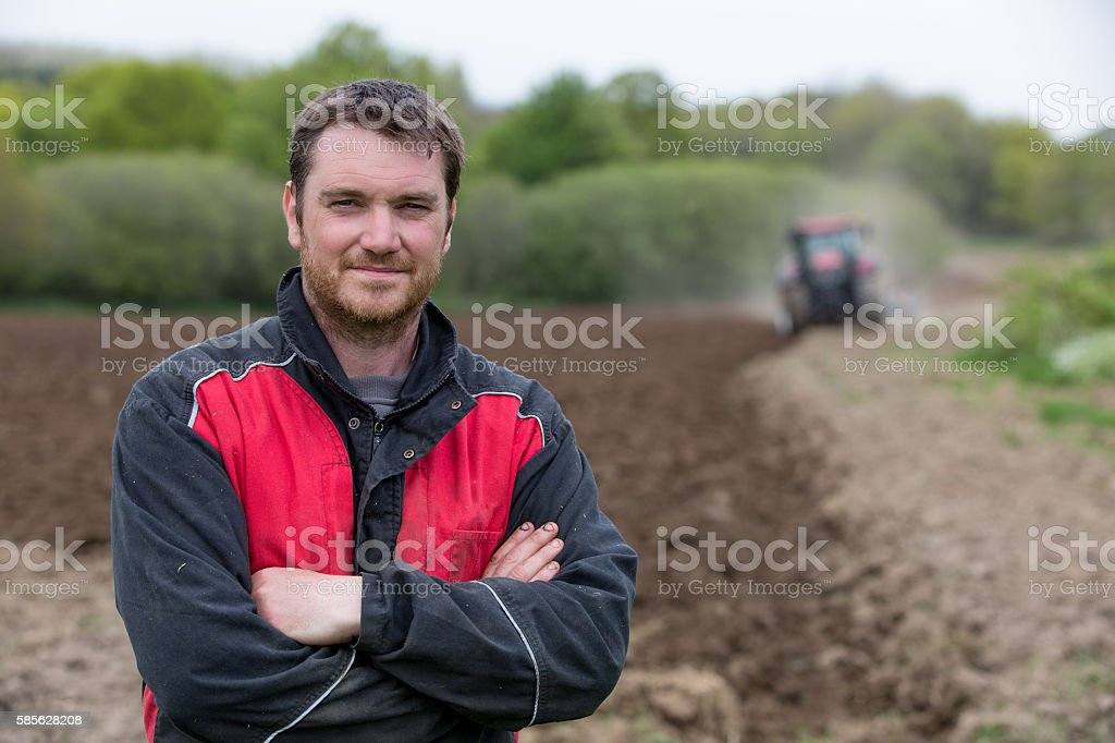 farmer showing new tractor stock photo