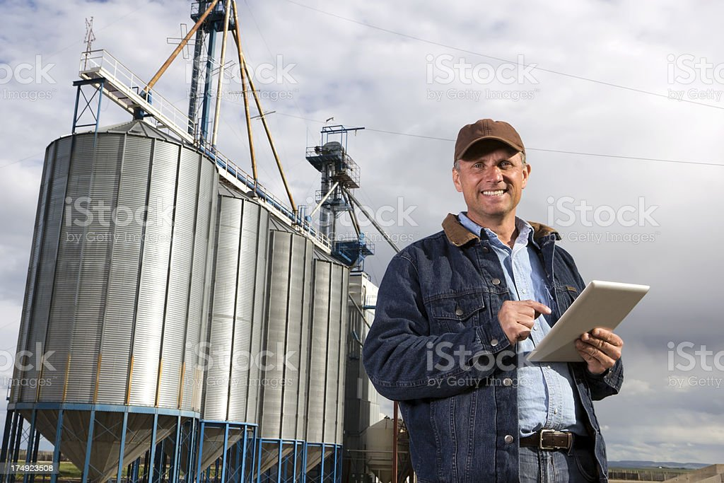 Farmer, Silos and PC royalty-free stock photo