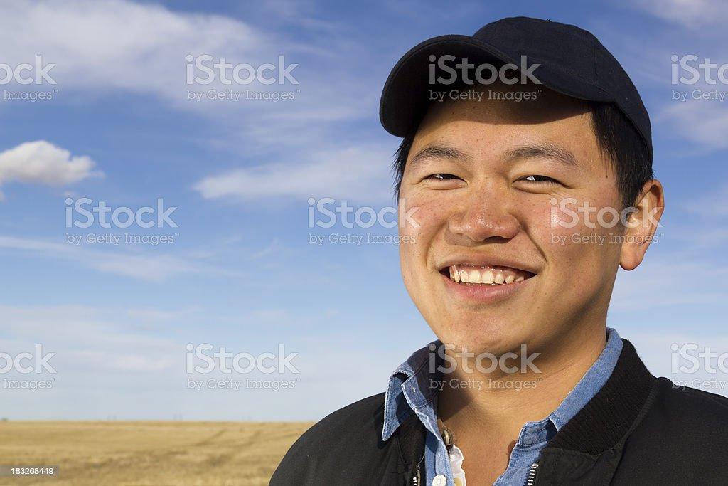 Farmer Smiling in Field stock photo
