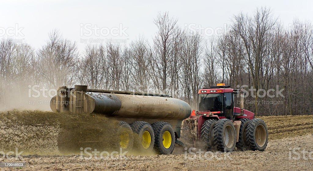Farmer Spreading Liquid Manure royalty-free stock photo