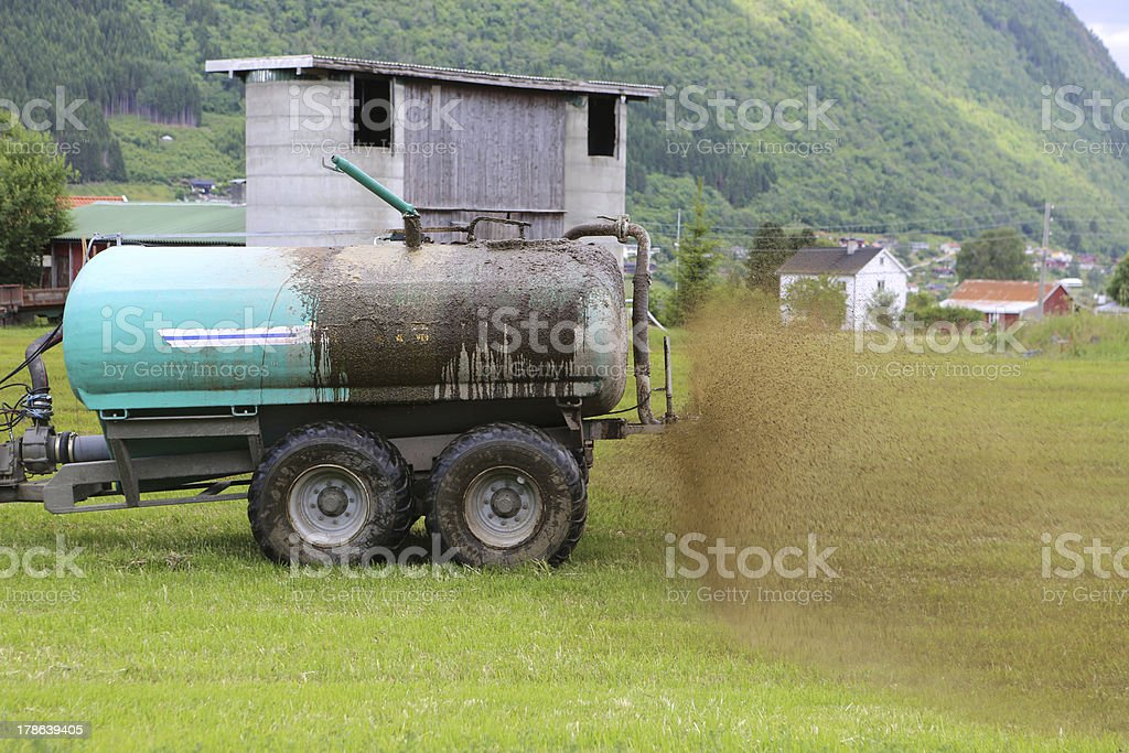 Farmer Spreading Liquid Manure royalty-free stock photo