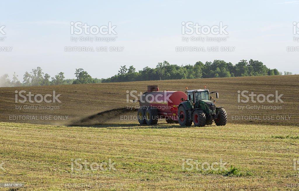 Farmer Spreading Liquid Manure stock photo